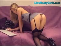 Blondie strips in front of the webcam